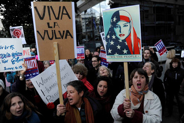 Women demonstrate in opposition to U.S. President Donald Trump outside the American embassy in Athens