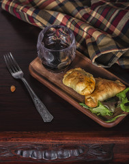Two lamb stuffed empanadas and a glass of red local wine in a patagonia argentina chic retreat.