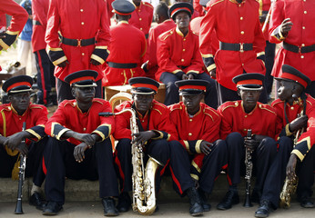 Musicians sit before the start of a rehearsal of the Independence Day ceremony in Juba