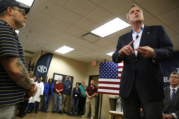 Bush holds a town hall meeting with employees at FN America gun manufacturers in Columbia, South Carolina