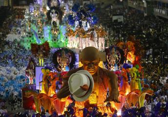 A reveler from the Beija Flor  samba school participates in the annual carnival parade in Rio de Janeiro's Sambadrome