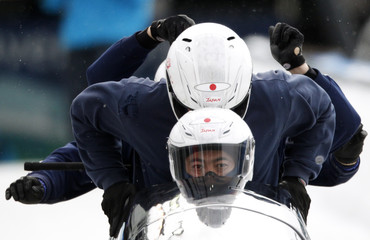 Japan's four-man bobsleigh team, piloted by Suzuki, begins its training heat at the Vancouver 2010 Winter Olympics in Whistler