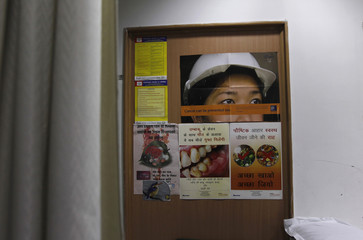 Anti-tobacco messages are seen on posters pasted on a wooden frame inside a hospital in New Delhi