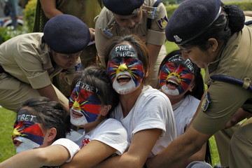 Tibetan exiles shout slogans as they are detained by police during a protest outside the Chinese embassy in New Delhi