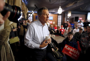 Republican U.S. presidential candidate John Kasich arrives for a meet and greet at the Inspired Grounds Cafe as he campaigns in West Des Moines