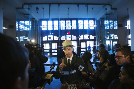 Superintendent of the Statue of Liberty and Ellis Island National Parks Luchsinger speaks to reporters inside of the Ellis Island immigration museum building in New York