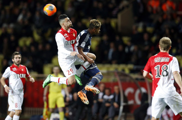 AS Monaco's Emmanuel Riviere challenges for the ball with Olympique Marseille's Mario Lemina during their French Ligue 1 soccer match at Louis II stadium in Monaco