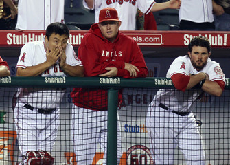 Los Angeles Angels Hank Conger and Bobby Wilson react in the dugout during the ninth inning of their MLB American League baseball game against the Texas Rangers in Anaheim
