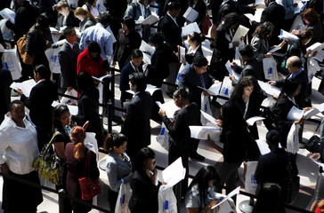 People wait in line to enter the CUNY Big Apple job fair in New York