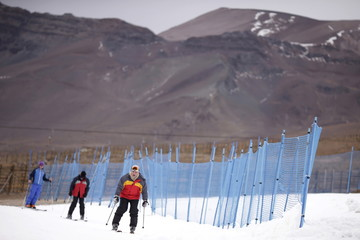 Skiers are pictured on artificial snow at the El Colorado ski centre at Los Andes Mountain range, near Santiago