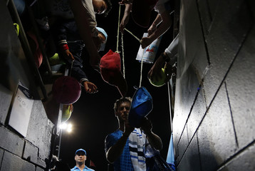 Italy's Seppi signs autographs after winning his second round match against Kudla of the U.S. at the Australian Open tennis tournament at Melbourne Park