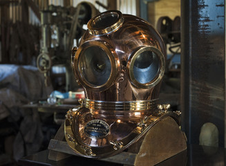 A finished diving helmet built by artisan Toth sits in the wood-frame shop in Tarpon Springs