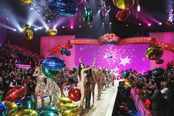 Models celebrate on stage after the Victoria's Secret Fashion Show in New York