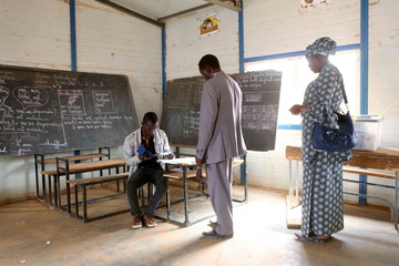 Voters queue to register at a polling station during the country's presidential and legislative elections in Niamey