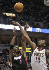 Miami Heat's Bosh has his shot blocked by Milwaukee Bucks' Luc Richard Mbah a Moute during their NBA game in Milwaukee
