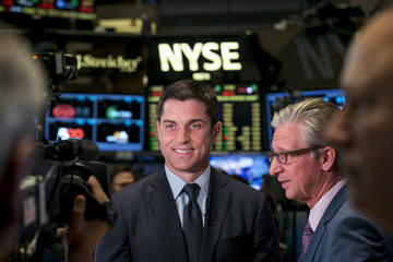 NYSE President Thomas Farley gives an interview on the trading floor during the Alibaba Group Holding Ltd IPO in New York
