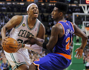 Boston Celtics Pierce drives past New York Knicks Shumpert during NBA Eastern Conference semifinal playoff basketball series in Boston