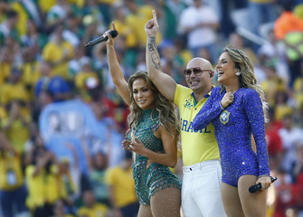 Singers Lopez, Pitbull and Leitte perform during the opening ceremony of the 2014 World Cup at the Corinthians arena in Sao Paulo