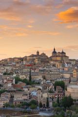 Toledo cathedral on hill top at sunset