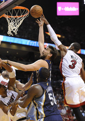Miami Heat  Wade blocks a shot by Memphis Grizzlies Gasol of Spain during their NBA game in Miami