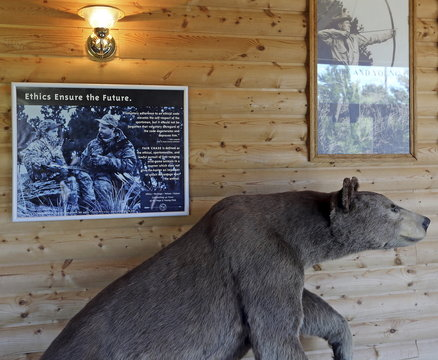 A poster promoting fair chase ethics in bowhunting hangs in the lobby of North American bow-hunting club Pope & Young's museum in Chatfield