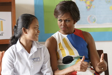 U.S. first lady Michelle Obama gestures during a visit to promote girls' education at Hun Sen Prasaat Bankong high school on the outskirts of Siem Reap
