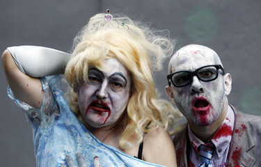 Revellers pose for pictures during the 32th annual gay and lesbian Mardi Gras parade in central Sydney