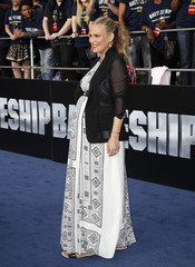 "Actress Molly Sims, who is pregnant, poses at the American premiere of Universal Pictures film ""Battleship"" in Los Angeles"