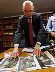 French prosecutor of Marseille, Robin, handles pictures showing the damaged black box data flight recorder during a press conference in Marseille