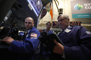Traders work on the floor of the New York Stock Exchange following its reopening in New York