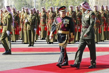 Jordan's King Abdullah walks with Jordanian Chief of Staff Al Zaben during the opening of the 17th Ordinary Session of Parliament in Amman