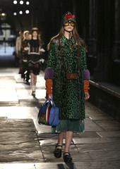 Models presents creations by Gucci at a catwalk show in the cloisters of Westminster Abbey in London