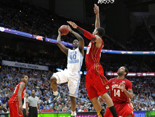 North Carolina Barnes shoots around Maryland Pankey during the first half of their ACC college basketball tournament game in Atlanta