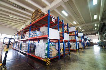 Rows of shelves with boxes interior warehouse