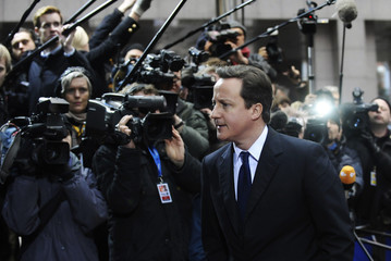 Britain's Prime Minister David Cameron arrives at an European Union leaders summit in Brussels