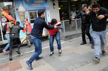 Turkish riot police use pepper spray while detaining a group of protesters who were attempting to defy a ban and march on Taksim Square to celebrate May Day, in Besiktas neighbourhood of Istanbul
