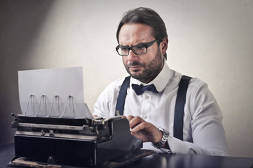 Gentleman using vintage typewriter