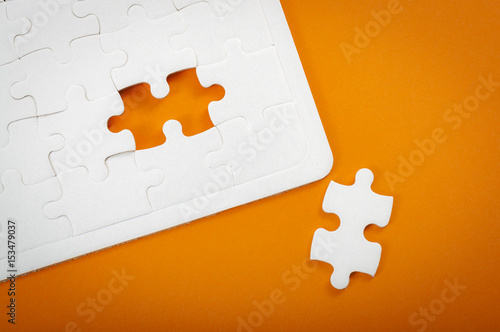 Completing Final Task Missing Jigsaw Puzzle Pieces And Business Concept With White Piece Next
