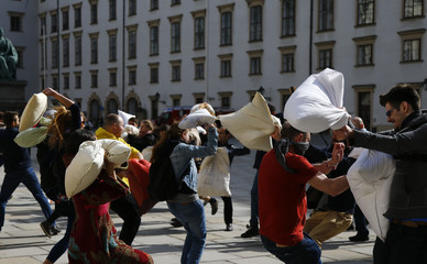 People fight with pillows during World Pillow Fight Day in Vienna
