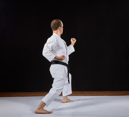In a karate stand, a sportsman makes a block with his hand Kaderov