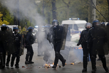 French riot police face off with French university students during a demonstration against the French labour law proposal in Nantes