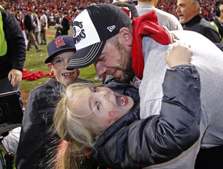 St. Louis Cardinals starting pitcher Carpenter celebrates with his son Sam and daughter Ava after the Cardinals defeated the Texas Rangers to win MLB's World Series baseball championship in St. Louis