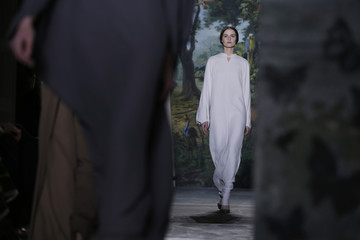 A model presents a creation by Italian designers Maria Grazia Chiuri and Pier Paolo Piccioli as part of their Haute Couture Spring/Summer 2014 fashion collection for fashion house Valentino in Paris