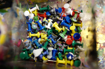 Colored pins are piled up in a box ready to use during an art class for children in the city of Hanau near Frankfurt