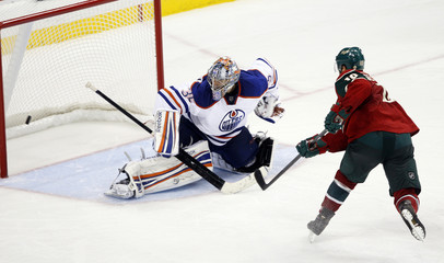 Wild's Setoguchi scores the game-winning goal against Oilers goalie Khabibulin during a shoot out in their NHL hockey game in St. Paul