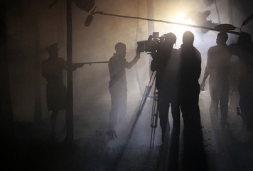 Actors perform a scene at night while filming 'October 1', a police thriller directed by Kunle Afolayan, at a rural location in Akure, southwest Nigeria