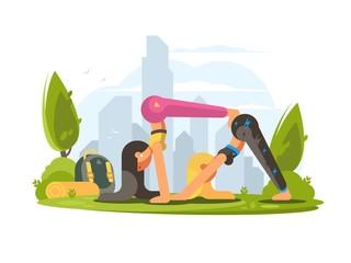 Girls practice yoga in park