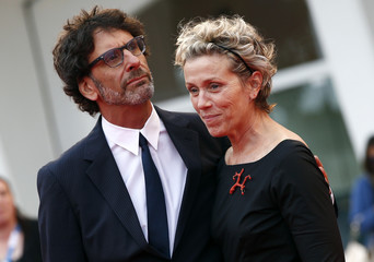 """Cast member McDormand and her husband Coen attend the red carpet for the tv mini-series """"Olive Kitteridge"""" at the 71st Venice Film Festival"""