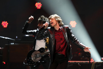 """Mick Jagger and Ron Wood of the Rolling Stones perform during the """"12-12-12"""" benefit concert for victims of Superstorm Sandy at Madison Square Garden in New York"""