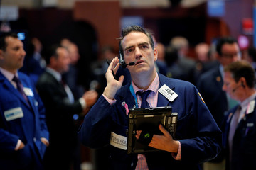A trader works on the floor of the New York Stock Exchange (NYSE) shortly after the opening bell in New York